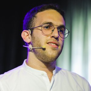 image: photo of Yuval Keshtcher, UX Writing Hub founder